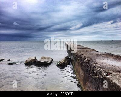 Pier in rocky river ohio out on Lake Erie - Stock Image