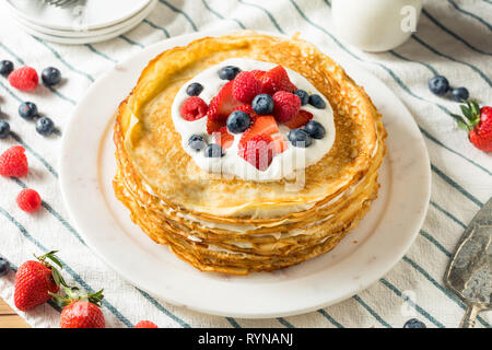 Sweet Homemade Layed Crepe Cake with Berries and Whippe Cream - Stock Image