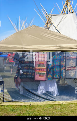 Vendor selling First Nations clothing at the Tsuut'ina  Annual Rodeo & Powwow, Bragg Creek Alberta Canada - Stock Image