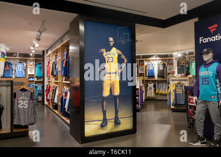 An area in the lower level inside the NBA store on Fifth Ave. in MIdtown, Manhattan, New York City. Showing player replica jerseys for sale. - Stock Image