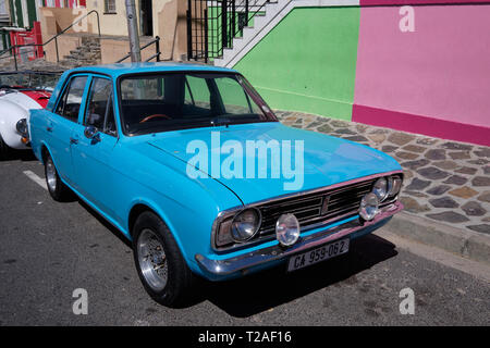 Blue Ford Cortina car, right side driving, parked on colourful streets of Bo Kaap, Cape Town, South Africa, March 21, 2019 - Stock Image
