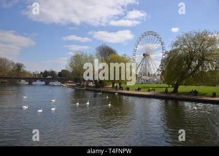 A big wheel or ferris wheel has been constructed on the bank of the River Avon, Stratford upon Avon, Warwickshire - Stock Image