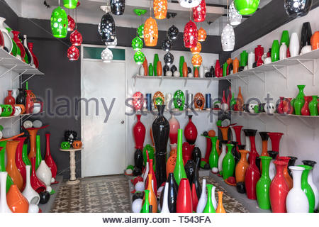 Decorative objects privately-run store in the living room of a house. The objects show vibrant diverse colors. Wide angle view - Stock Image