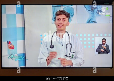 Cartagena Colombia TV television monitor screen flat screen medical show telemarketing Hispanic man - Stock Image