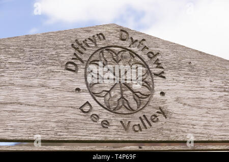 Wooden tourism sign post in the the Dee Valley or Dyffryn Dyfrdwy in Llantysilio near Llangollen North Wales - Stock Image