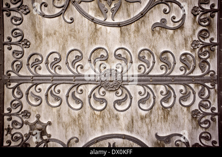 Toned image of a gothic pattern on a wooden doorway as a background. - Stock Image