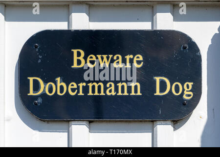 Beware Doberman dog sign - Stock Image