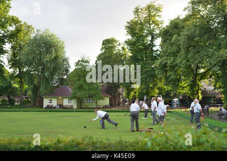 Local Cambridge Bowls club meet in the city centre park and play a game of bowls in their whites - Stock Image