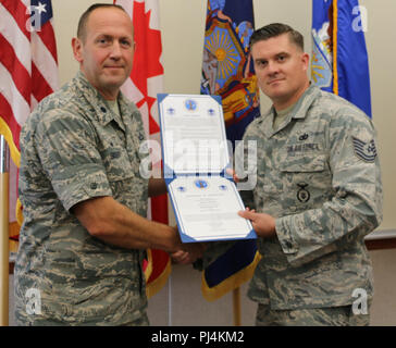 Master Sgt. Sean Redden received his rank during a promotion ceremony held on Aug. 29 at the Eastern Air Defense Sector. Lt. Col. Paul Bishop, left, the Commander, 224th Support Squadron, served as the promoting officer. - Stock Image