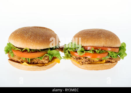 tasty unhealthy chicken burgers isolated on white - Stock Image