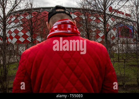 Football fan near the central entrance of the Spartak football stadium 'Otkritie Arena' in Tushino district of Moscow city, Russia - Stock Image