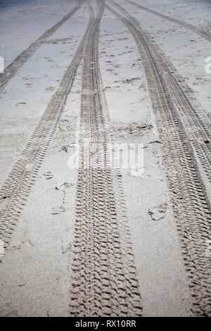 Tire Tracks on Sand - Stock Image
