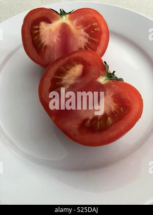 Red tomato cut in half - Stock Image