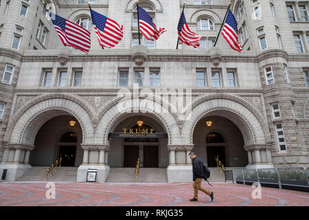 A man walks past the Trump International Hotel in Washington, DC on January 12, 2019. - Stock Image