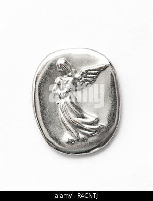A silver Christian guardian angel to carry in a pocket for protection and healing. - Stock Image