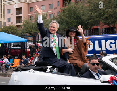 Texas Gov. Greg Abbott and his wife, Cecilia, wave to crowd during annual Washington's Birthday Celebration parade in downtown Laredo. - Stock Image