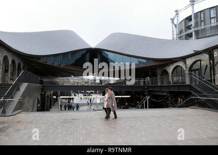 People strolling near shops at Coal Drops Yard shops in the Kings Cross redevelopment area of London UK  KATHY DEWITT - Stock Image