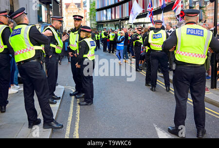 London, England, UK. Police officers policing a crowd outside the Old Bailey, May 2019 as Tommy Robinson is sent for retrial on contempt charges - Stock Image