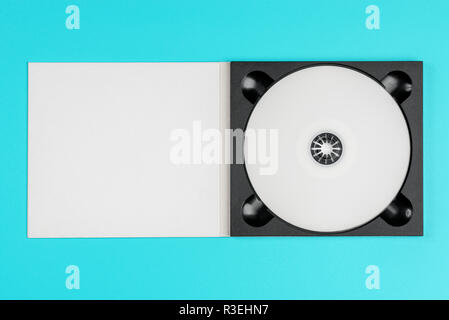 White cd in black case on pastel green background - Stock Image