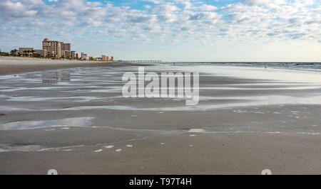 Pooling water along the shoreline at Jacksonville Beach in Northeast Florida. (USA) - Stock Image