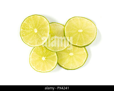 sliced lime on a white background - Stock Image