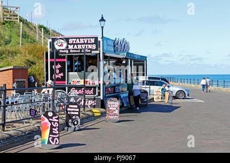 A seasonal food and drink cabin on the promenade at the North Norfolk seaside resort of Cromer, Norfolk, England, United Kingdom, Europe. - Stock Image