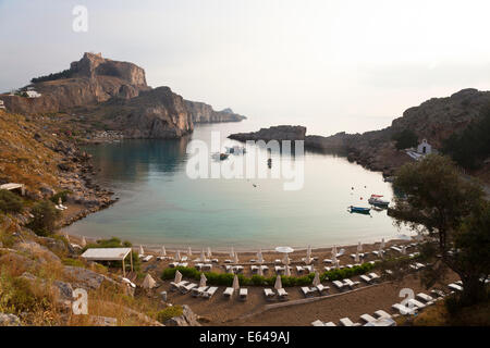 St Pauls Harbour, beach and Acropolis, Lindos Rhodes Greece - Stock Image
