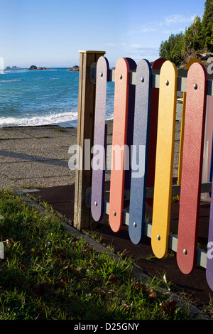A colorful playground for the kids, by the beach. - Stock Image