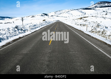 Perspective shot of road in snowy Colorado during winter - Stock Image