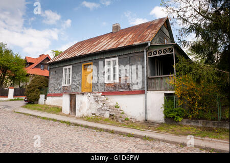 Old house in Janowiec village at Lubelska Street, dilapidated old weathered architecture, private property building - Stock Image