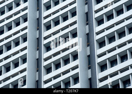 A nondescript anonymous high rise building of apartments or offices in Singapore - Stock Image