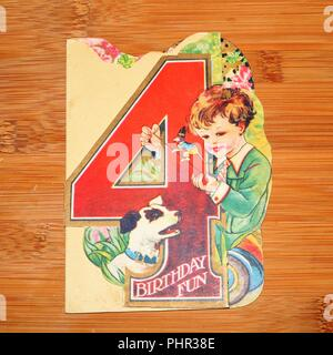 Vintage Greeting Card showing number four with boy and dog  - social history - Stock Image