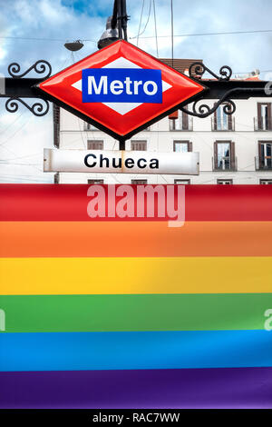 Madrid Chueca Metro station on Plaza de Chueca Madrid, Spain decorated with a rainbow flag in the heart of Madrid's LGBT gay district. - Stock Image