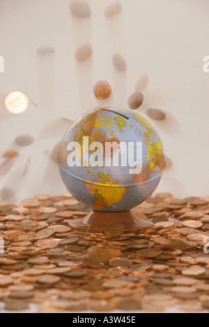 USA pennies falling on globe bank - Stock Image