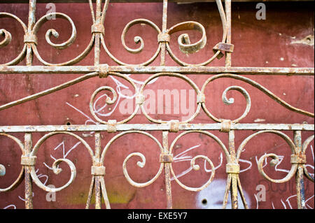 Part of an old ornate metal gate - Stock Image