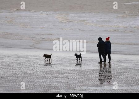 Hastings, East Sussex, UK. 12 Jan, 2019. UK Weather: Winter weather with a slight breeze in the air that is expected to last throughout the day as a few people take a morning stroll around the seafront as the tide is out. © Paul Lawrenson 2018, Photo Credit: Paul Lawrenson / Alamy Live News - Stock Image