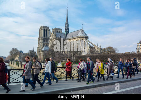 tourists by notre dame cathedral, Paris, France - Stock Image