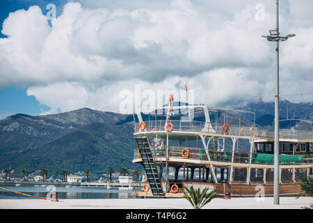 Beautiful view of the mountains and the ship off the coast of Tivat in Montenegro. - Stock Image