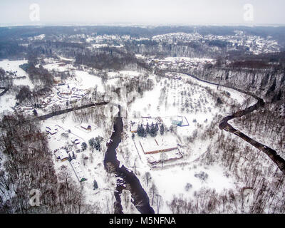 Vilnius, Lithuania: aerial top view of Vilnele river and Belmontas park in beautiful colors of winter - Stock Image
