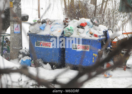 UKRAINE, Odessa - February 27, 2018: snow in the city, transport collapse, garbage is not exported, environmental - Stock Image