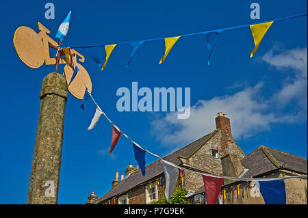 Bunting hanging across the street in the Yorkshire town of Middleham - Stock Image