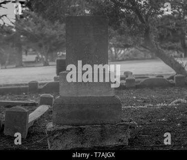 Black and white rendering of graveyards in cemetery in the fog - Halloween composition with space for names and inscriptions - Stock Image
