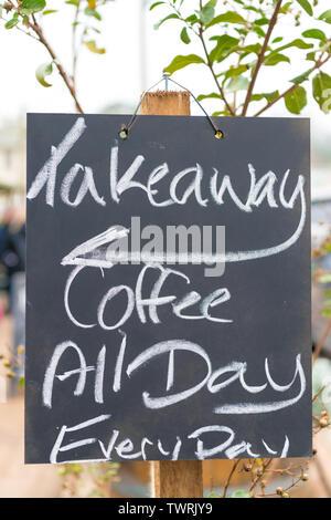 Takeaway coffee sign written with chalk on blackboard - Stock Image