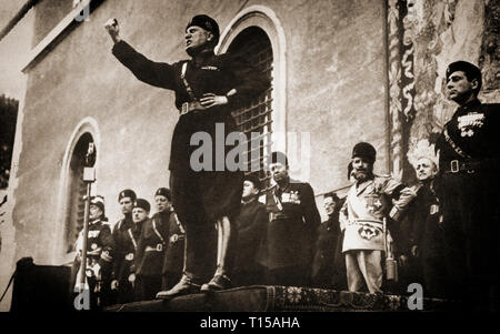 A speech from Benito Mussolini (1883- 1945), Italian politician and journalist who became leader of the National Fascist Party. In October 1922, Mussolini became the youngest Prime Minister in Italian history, removed all political opposition through his secret police. He and his followers consolidated their power through a series of laws that transformed the nation into a one-party dictatorship. Within five years, Mussolini had established dictatorial authority by both legal and extraordinary means and aspired to create a totalitarian state. After the Abyssinia Crisis of 1935–1936, Mussolini  - Stock Image