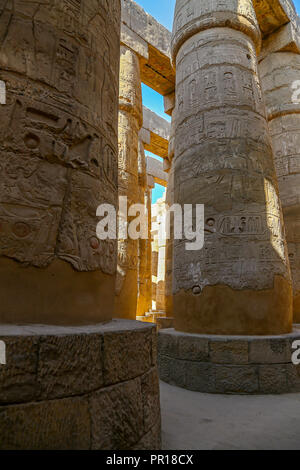 The Hypostyle Hall in the Temple of Amun at the Karnak Temple Complex, also known as The Temple of Karnak, in Thebes, Luxor, Egypt - Stock Image