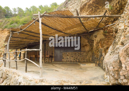 A rustic beach shelter in Deia provides relief from the sun on a warm summer's day in Mallorca, Spain. - Stock Image
