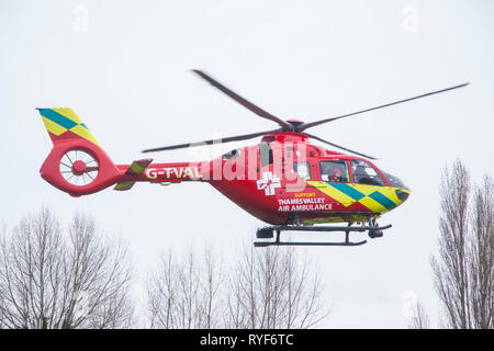 Air Ambulance paramedics return from attending a road traffic accident to the Thames Valley Air Ambulance - Stock Image