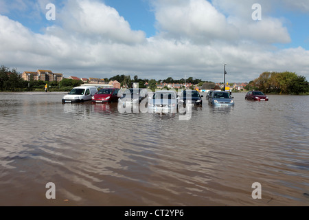 Weymouth Rains Flood Radipole Car Park Prior to the Weymouth Sailing Olympics with Cars Underwater - Stock Image