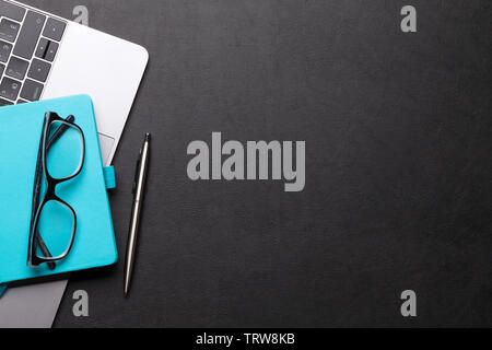 Office workplace table with supplies and computer. Flat lay. Top view with space for your goals - Stock Image
