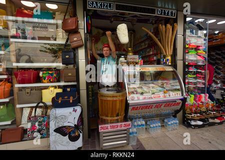 KUSADASI, TURKEY - MAY 23, 2015: A man in traditional Turkish costume sells ice cream on the street in Kusadasi, Turkey - Stock Image